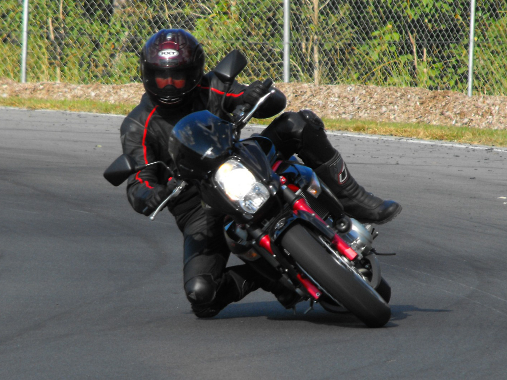 A Racetrack is the place to practice fast cornering, full leathers is a must.